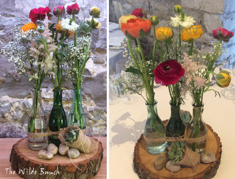 Rustic wedding flower ideas with log slices and bottles