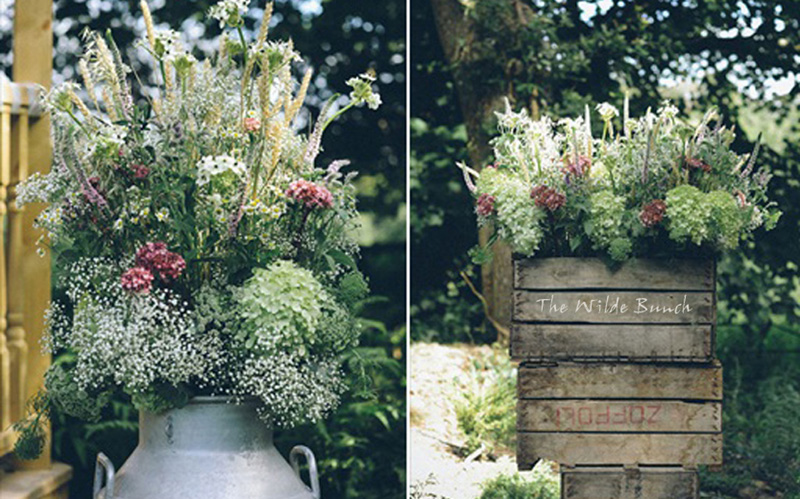 Crate stack and millk churn wedding flowers