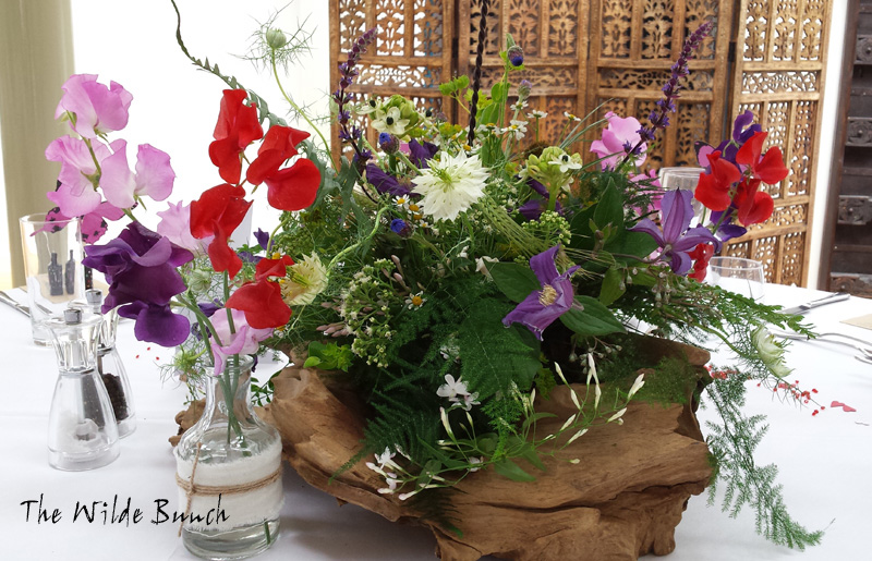 Rustic wedding flowers, table centre design