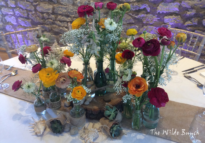 Rustic wedding ideas, log slice and bottles