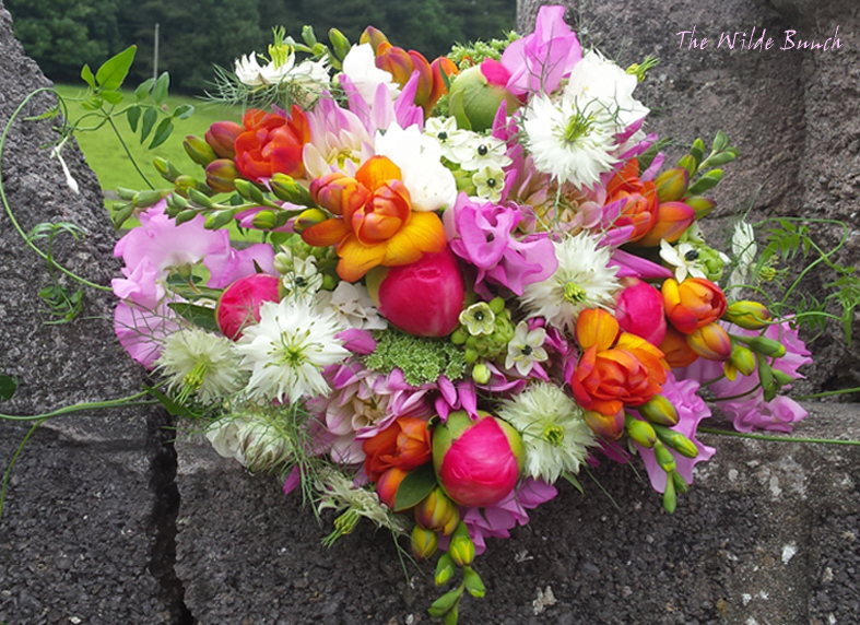 Bright coloured vibrant wedding bouquet