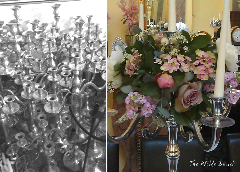 Silver wedding candelabra dressed with wedding flowers. The Wilde Bunch Barn is literally heaving with silver candelabra in various sizes