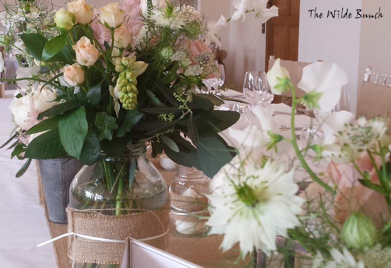 Simple wedding flower ideas using bottles and jars